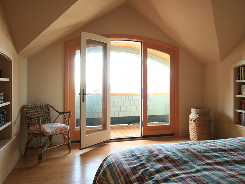 architect designed cottage addition - lake huron - bedroom doors to lakeside balcony